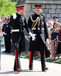 Prince Harry (left) walks with his best man, the Duke of Cambridge, as he arrives at St George's Chapel at Windsor Castle for his wedding to Meghan Markle.