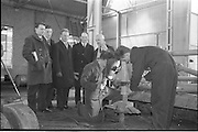 21/02/1963.02/21/1963.21 February 1963.Teachers tour Bord na Mona workshops. Vocational school teachers, whose past pupils include Bord na Mona apprntices, were guests at three of the Board's workshops., to study the organisation of the workshops and watch apprntices on the job. Watching fitter Stan Mulrin and 2nd year apprentice Seamus Kilmurray works at Derrygreenagh milled-peat works, Co. Offaly, (l-r) were teachers M. Hillery (Portarlington V.S.), S. Crowley (Tullomore V.S.), A. Egan (Portarlington V.S.), B. Clancy (Lanesboro' V.S.) and John Murphy, Workshop Foreman.