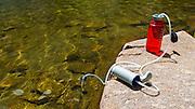 Water purifier on the shore of Fern Lake, Ansel Adams Wilderness, June Lake, California USA