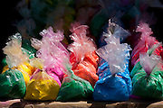 Bags of powder colours on sale for traditional Hindu Holi festival in old town Udaipur, Rajasthan, Western India