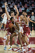Southern California Trojans forward Evan Mobley (4) is double teamed by Stanford Cardinal forward Spencer Jones (14) and forward Lukas Kisunas (32) during an NCAA men's basketball game, Wednesday, March 3, 2021, in Los Angeles. USC defeated Stanford 79-42. (Jon Endow/Image of Sport)
