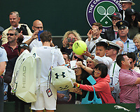 Tennis - 2017 Wimbledon Championships - Week Two, Wednesday [Day Nine]<br /> <br /> Men's Singles, Quarter Final match<br /> <br /> Andy Murray (GBR) vs. Sam Querrey (USA)<br /> <br /> Andy Murray signs a couple of autographs as he walks off after defeat on  Centre Court <br /> <br /> COLORSPORT/ANDREW COWIE