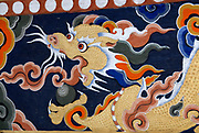 Representation of a dragon painted in traditional Bhutanese style.   This the Bhutanese national symbol, Druk, the thunder dragon. Paro Dzong, Druk Yul, Kingdom of Bhutan. 10 November 2007.