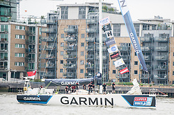 © Licensed to London News Pictures. 30/08/2015. London, UK. The twelve yachts competing in the Clipper Round the World race pass by Tower Bridge ahead  of their 40,000 mile, 11 month race.  Each yacht carries a crew of 22, with only the skipper a professional yachtsman. The remainder are amateurs, many of whom had never sailed before taking up the challenge.. Photo credit : Stephen Chung/LNP