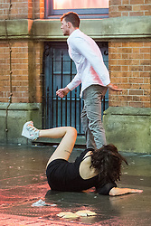© Licensed to London News Pictures . 01/01/2015 . Manchester , UK . A woman falls to the ground as she pushes a man away from a bouncer outside Victoria's Lap Dancing Bar on Dantzic Street . Revellers usher in the New Year on a night out in Manchester City Centre .  Photo credit : Joel Goodman/LNP