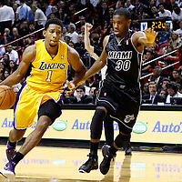 19 January 2012: Los Angeles Lakers guard Darius Morris (1) drives past Miami Heat point guard Norris Cole (30) during the Miami Heat 98-87 victory over the Los Angeles Lakers at the AmericanAirlines Arena, Miami, Florida, USA.