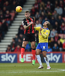 Bournemouth's Steve Cook heads the ball away from Huddersfield Town's James Vaughan - Photo mandatory by-line: Paul Knight/JMP - Mobile: 07966 386802 - 14/02/2015 - SPORT - Football - Bournemouth - Goldsands Stadium - AFC Bournemouth v Huddersfield Town - Sky Bet Championship
