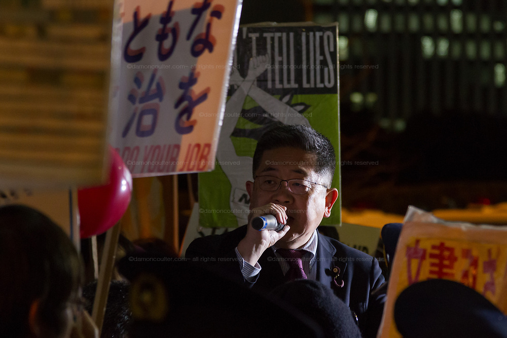 Akira Koike of the Japanese Communist Party talks to hundreds of students and other activists  as they protest outside the Japanese Prime Minister's office calling on the Japanese Prime Minister, Shinzo Abe and Finance Minister, Taro Aso to resign over a suspected cover-up of the Moritomo Gakuen school  land sale scandal and falsified documents. Kasumigaseki, Tokyo, Japan Friday, March 23rd 2018