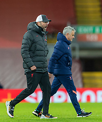 LIVERPOOL, ENGLAND - Wednesday, December 16, 2020: Liverpool's manager Jürgen Klopp (L) celebrates at the final whistle as Tottenham Hotspur's manager José Mourinho looks dejected during the FA Premier League match between Liverpool FC and Tottenham Hotspur FC at Anfield. Liverpool won 2-1. (Pic by David Rawcliffe/Propaganda)