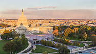 USA, Washington, D.C. The U.S. Capitol Building, the Capitol Visitor Center, and Northwest Washington in autumn sunrise light as seen from the Library of Congress.