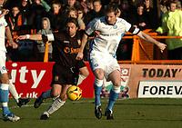 Photo: Ian Hebden.<br /> <br /> Barnet FC v Wycombe Wanderers. Coca Cola League 2. 21/01/2006.<br /> <br /> Barnets Giuaiano Grazioli (L) challenges Wycombes Matt Williamson (R)