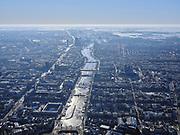 Nederland, Noord-Holland, Amsterdam, 13-02-2021; winter in Amsterdam, Amstel in tegenlicht, gezien vanaf de Stopera op het Waterlooplein, Blauwbrug onder in beeld.<br /> Winter in Amsterdam, Amstel in backlight, seen from the Stopera on the Waterlooplein, Blauwbrug at the bottom of the screen.<br /> <br /> luchtfoto (toeslag op standaard tarieven);<br /> aerial photo (additional fee required)<br /> copyright © 2021 foto/photo Siebe Swart