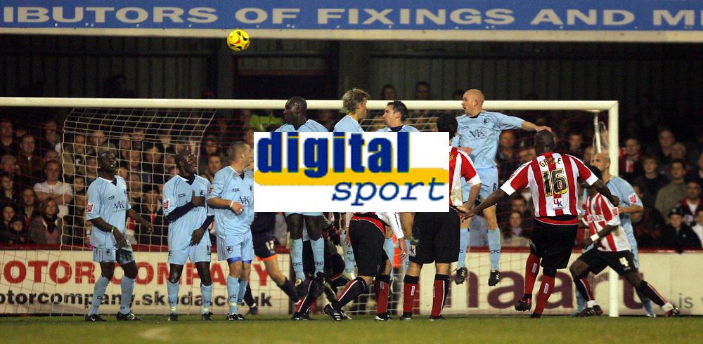 Photo: Frances Leader.<br />Brentford v Chesterfield. Coca Cola League 1. <br />10/12/2005.<br />Brentfords' Isaiah Rankin (R) takes a free kick.