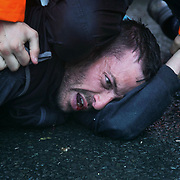 Day two of the Rolling Resistance, Preston New Road, Lancashire. Security violently try to prevent climate protectors to lock-on at the gates to Quadrilla drill site. One activists was restrained by the site manager using pressure points to the neck and throat and put in a neck lock by security staff on the road outside Quadrilla's property. Two activists managed to lock themselves down and block the gates.  A lock-on, where two or more lock themselves together inside a re-inforced tube is used as a peaceful non-violent way of blocking the gates.to the site.The New Preston Road Quadrilla site is almost ready to start drilling for shale gas after many delays caused by local objections. Lancashire County council voted against fracking but the conservative central government forced it through.