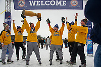 The Boston Beauties hoist the trophy after their win over the UBears in the final round of the New England Pond Hockey Classic Sunday afternoon.  (Karen Bobotas/for the Laconia Daily Sun)