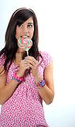 Teen eats a lollipop