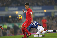 Roberto Firmino of Liverpool goes past Ramiro Funes Mori of Everton during the English Premier League match at Goodison Park, Liverpool. Picture date: December 19th, 2016. Photo credit should read: Lynne Cameron/Sportimage