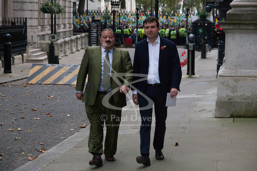 Trafalgar Square, London, October 26th 2014. Thousands of Kashmiris in London demonstrate in Trafalgar Square before marching to Downing Street to deliver a petition asking for Britain's support in ending the occupation of Kashmir by India. PICTURED: Former Prime Minister of Azad Jammu and Kashmir, Barrister Sultan Mahmood Chaudary Arrvise at Downing street to be met by a representative from Number 10, to receive the petitition.