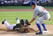 CHICAGO - JUNE 27:  DeWayne Wise #31 of the Chicago White Sox slides into third base with a triple in the sixth inning against the Chicago Cubs on June 27, 2009 at U.S. Cellular Field in Chicago, Illinois.  The White Sox defeated the Cubs 8-7.   (Photo by Ron Vesely)
