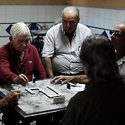 Playing domino in a bar in Aldeanueva del Camino, Caceres province, Extremadura region, Spain . The WAY OF SAINT JAMES or CAMINO DE SANTIAGO following the Silver Way, between Seville and Astorga, SPAIN. Tradition says that the body and head of St. James, after his execution circa. 44 AD, was taken by boat from Jerusalem to Santiago de Compostela. The Cathedral built to keep the remains has long been regarded as important as Rome and Jerusalem in terms of Christian religious significance, a site worthy to be a pilgrimage destination for over a thousand years. In addition to people undertaking a religious pilgrimage, there are many travellers and hikers who nowadays walk the route for non-religious reasons: travel, sport, or simply the challenge of weeks of walking in a foreign land. In Spain there are many different paths to reach Santiago. The three main ones are the French, the Silver and the Coastal or Northern Way. The pilgrimage was named one of UNESCO's World Heritage Sites in 1993. When there is a Holy Compostellan Year (whenever July 25 falls on a Sunday; the next will be 2010) the Galician government's Xacobeo tourism campaign is unleashed once more. Last Compostellan year was 2004 and the number of pilgrims increased to almost 200.000 people.