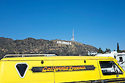 """© Licensed to London News Pictures. 15/02/2015. Los Angeles, USA A van with the words """"California Dreaming"""" parked near to the sign. Tourists photograph the Hollywood sign in Los Angeles, California. Photo credit : Stephen Simpson/LNP"""