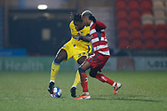 Darnell Johnson of AFC Wimbledon dummies Doncaster midfielder Elliot Simões   during the EFL Sky Bet League 1 match between Doncaster Rovers and AFC Wimbledon at the Keepmoat Stadium, Doncaster, England on 26 January 2021.