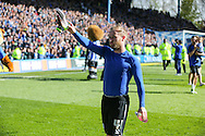 Sheffield Wednesday midfielder Barry Bannan (41) gives his boots to the crowd during the Sky Bet Championship match between Sheffield Wednesday and Cardiff City at Hillsborough, Sheffield, England on 30 April 2016. Photo by Phil Duncan.