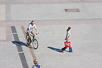 People cycling and walking on the Rynek in Krakow Poland