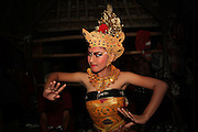 A young female dancer is practicing backstage before her performance in Kecak dance in Batubulan. Kecak is the most unique Balinese dance in which, instead of music, 100 men chant Cak. In the 1930s Ramayana story was added to the original trance dance.