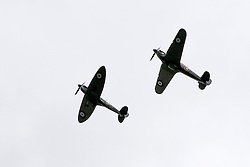 A Hurricane and A Spitfire from the Battle of Britain Memorial Flight flypast late on Saturday afternoon at the Hull Veterans Weekend<br /> <br /> 25-26 July 2015<br />  Image © Paul David Drabble <br />  www.pauldaviddrabble.co.uk