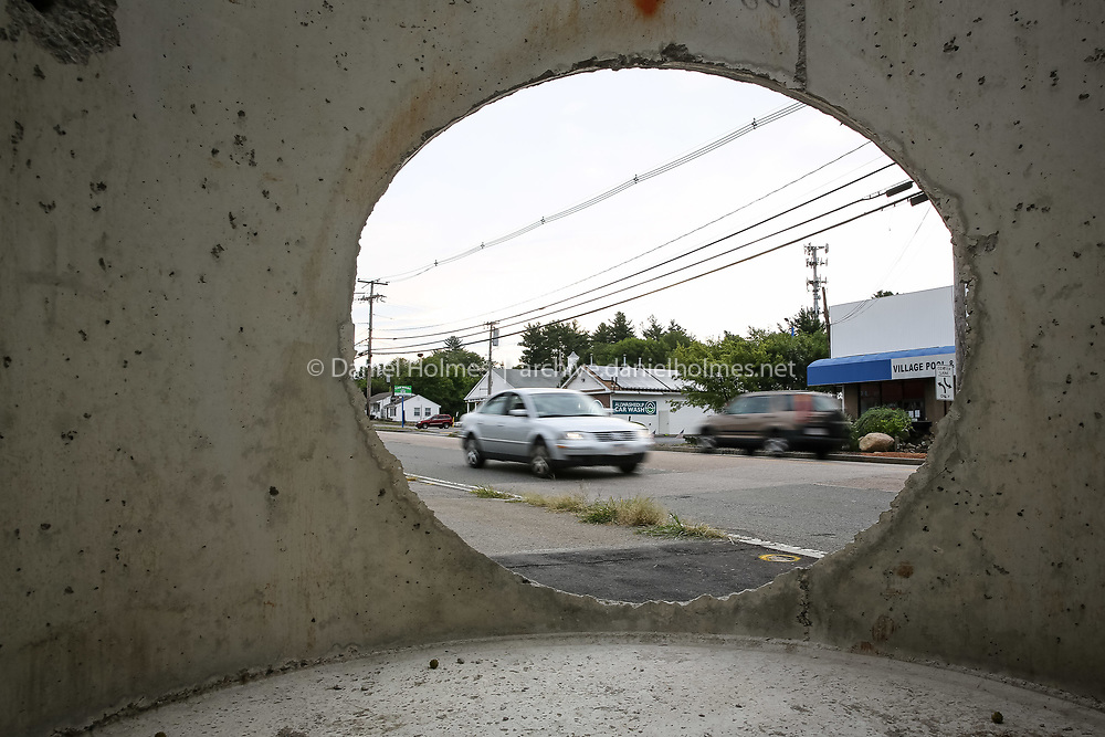 (8/29/16, MEDWAY, MA) Cars pass by a concrete drainage structure that is part of $10 million in road improvements that are under way along Rte. 109 in Medway. Daily News and Wicked Local Photo/Dan Holmes