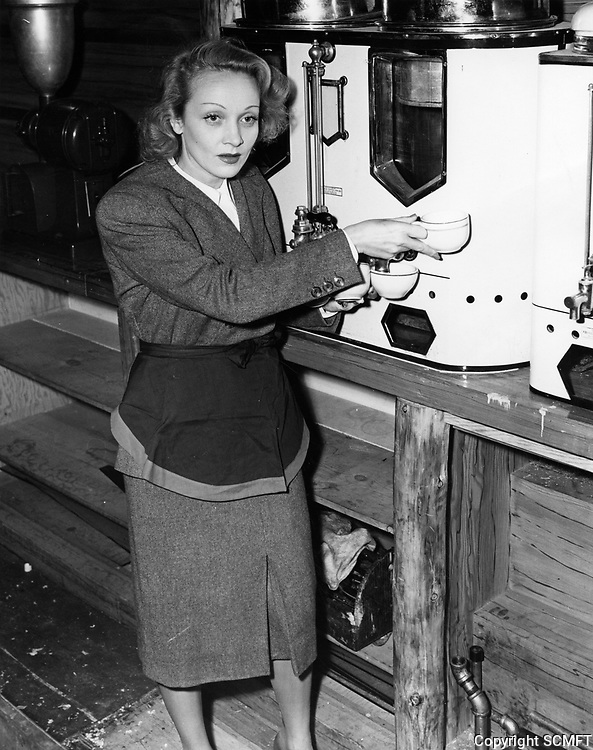 10/5/42 Marlene Dietrich gathers coffee to serve to servicemen at the Hollywood Canteen