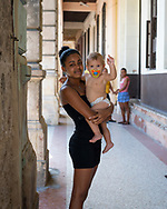 Young woman and baby in Havana, Cuba. (December 4, 2014)