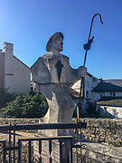 Villafranca del Bierzo, Spain. Modern sculpture of a pilgrim on the bridge over the Rio Burbia