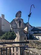 Villafranca del Bierzo, Spain. Modern sculpture of a pilgrim on the bridge over the Rio Burbia