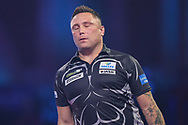 Gerwyn Price reaction after missing a dart at a double during the PDC William Hill World Darts Championship Semi-Final at Alexandra Palace, London, United Kingdom on 30 December 2019.