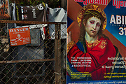 Electric sub station with a poster of Jesus for a Christian meeting on 28th February 2018 in Kochi, Kerala, India. A significant portion of the Indian Christian population resides in the state.
