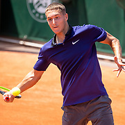 PARIS, FRANCE June 10. Sean Cuenin of France in action against Shang Juncheng of China in the quarter finals of the Junior Singles competition at the 2021 French Open Tennis Tournament at Roland Garros on June 10th 2021 in Paris, France. (Photo by Tim Clayton/Corbis via Getty Images)