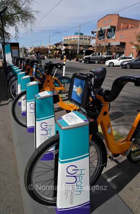 Bicycles are available for rent along University Boulevard near the Main Gate of the University of Arizona campus, Tucson, Arizona, USA.
