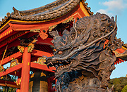 "Wood dragon sculpture. Kiyomizu-dera (""Pure Water Temple"") is an independent Buddhist temple in eastern Kyoto, Japan. Otowa-san Kiyomizu-dera temple is part of the Historic Monuments of Ancient Kyoto (Kyoto, Uji and Otsu Cities) UNESCO World Heritage site. Kiyomizu-dera was founded on the site of the Otowa Waterfall in the early Heian period, in 780 by Sakanoue no Tamuramaro. Ordered by Tokugawa Iemitsu, its present buildings were built entirely without nails in 1633."