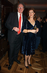 The HON.CHRISTOPHER & MRS GILMOUR at a party to celebrate the publication of 'Dancing into Waterloo' by Nick Foulkes held at The Westbury Hotel, Conduit Street, London on 14th December 2006.<br /><br />NON EXCLUSIVE - WORLD RIGHTS