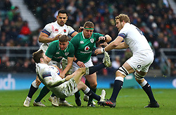 England's Elliot Daly (left) is tackled by Ireland's Jordan Larmour (second left) during the NatWest 6 Nations match at Twickenham Stadium, London.