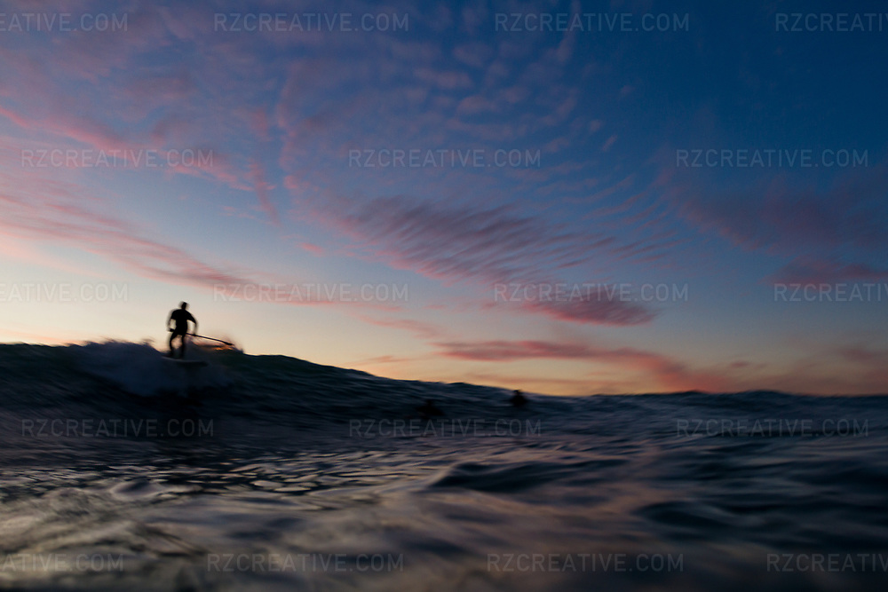 Water shot of a SUP surfer at sunset. Photo © Robert Zaleski / rzcreative.com<br /> —<br /> To license this image contact: robert@rzcreative.com