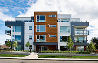 The exterior of a new condominium building in Sidney, BC, enginnered by Skyline Engineering, sets the tone for modern ocean-side living.