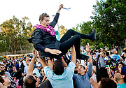 CK Gillebaard is tossed into the air by friends as he celebrates graduating from Aliso Niguel High School in Aliso Viejo, CA.