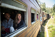 Two travelers from Denmark sit on a train during the scenic, several-hour journey from Nuwara Eliya to Ella, Sri Lanka.