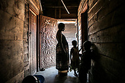 Masika Katsuva stands with the orphans she was taking care of inside her compound of transit centers and the orphanage in Minova, South Kivu. A victim of sexual violence herself, she was violated by at least 12 armed rebels after witnessing the killing of her husband in Vitchumbi in 1998. Two of her daughters and her mother were also violated. However, she defied the odds and became the community leader of 770 women and run the shelter for 19 victims of sexual violence and 49 war orphans and children who were born out of rape in Buganga.