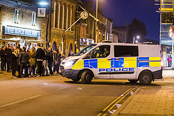 © Licensed to London News Pictures. 13/01/2018. Whittlesey UK. Picture shows police officers on Market street in Whittlesey where there has been an alleged stabbing at the The 39th Straw Bear Festival in Whittlesey, it is unclear where the incident happened but police activity is concentrated around a Kebab shop on Market street. The Straw Bear festival is taking place this weekend. In times past when starvation bit deep the ploughmen of the area where drawn to towns like Whittlesey, They knocked on doors begging for food & disguised their shame by blackening their faces with soot. In Whittlesey it was the custom on the Tuesday following Plough Monday to dress one of the confraternity of the plough in straw and call him a Straw Bear. The bear was then taken around town to entertain the folk who on the previous day had subscribed to the rustics, a spread of beer, tobacco & beef. The bear was made to dance in front of houses & gifts of money, beer & food was expected.Photo credit: Andrew McCaren/LNP