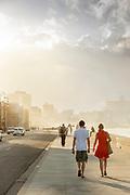 View of tourists walking near bay, Havana, Cuba
