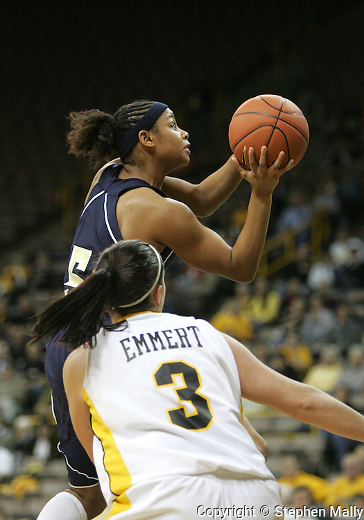 28 NOVEMBER 2007: Georgia Tech guard Jill Ingram (5) puts up a shot in front of Iowa guard Abby Emmert (3) in the second half of Georgia Tech's 76-57 win over Iowa in the Big Ten/ACC Challenge at Carver-Hawkeye Arena in Iowa City, Iowa on November 28, 2007.